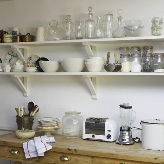 Attractive Grouping Like Items On Open Shelves Adds Interest In The Kitchen