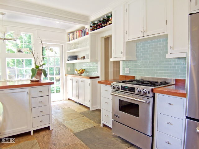 connecticut kitchen with glass tiled backsplash wood counters stone