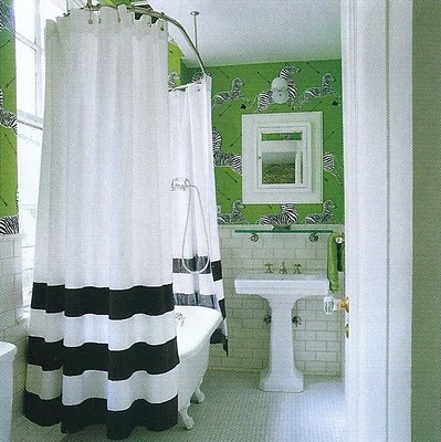 A Ceiling Mounted Clawfoot Tub Shower Enclosure And Funky Wallpaper In Kate  Spadeu0027s Guest Bathroom